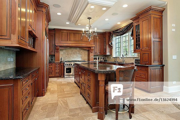 Kitchen in luxury home with large granite island. Northern Suburbs of Chicago  IL. USA.