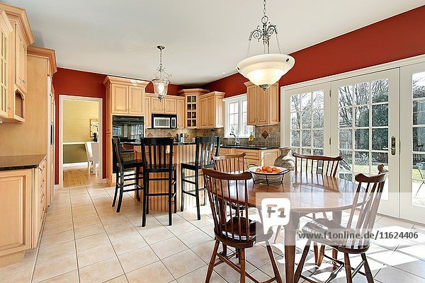 Kitchen in upscale home with oak wood cabinetry. Northern Suburbs of Chicago  IL. USA.
