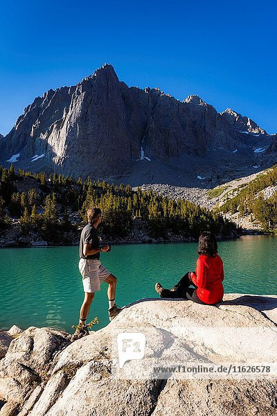 Hikers enjoying the view from Big Pine Lake #3  John Muir Wilderness  Sierra Nevada Mountains  California USA.