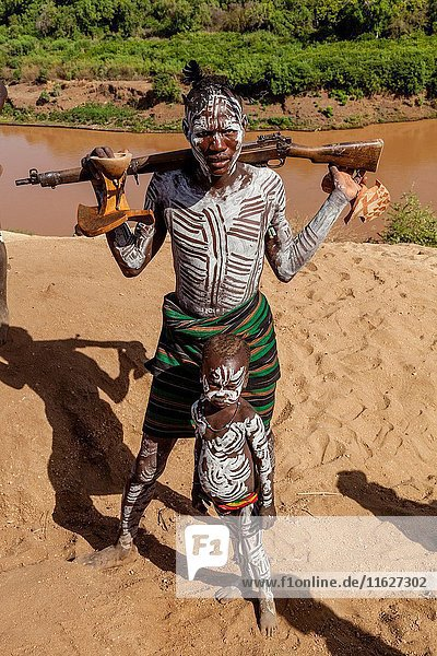 A Father and Son From The Karo Tribe,  Kolcho Village,  Omo Valley,  Ethiopia.