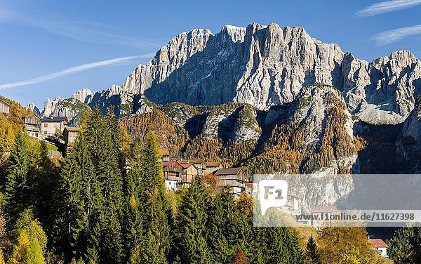 Mount Civetta in the Veneto. La Civetta is one of the icons of the Dolomites. In the foreground villages of San Tomaso Agordino. The Dolomites of the Veneto are part of the UNESCO world heritage. Europe  Central Europe  Italy  October.