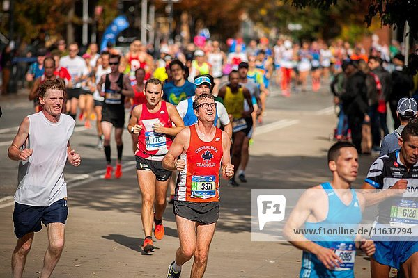 Runners pass through Harlem in New York near the 22 mile mark near Mount Morris Park on Sunday  November 6  2016 in the 46th annual TCS New York City Marathon. About 50  000 runners from over 120 countries are expected to compete in the race  the world's largest marathon.