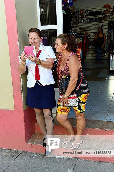 Two women distracted by smartphone  Remedios  Cuba.