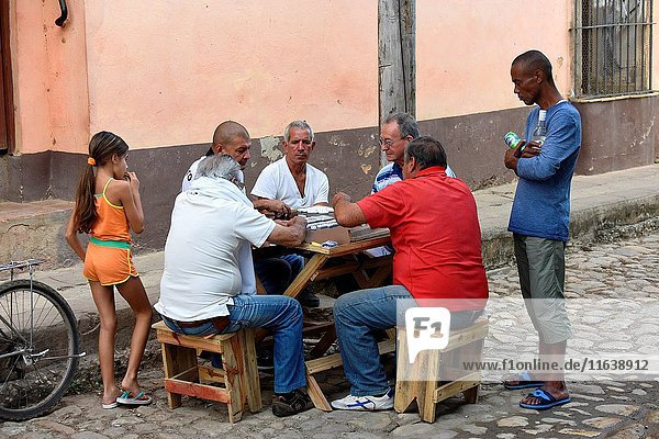 Cuban men playing domino in a sreet of Trinidad  Cuba.
