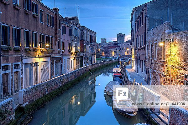 Typical view of an alley and canal in Venice at dusk  in the Accademia district  Italy.