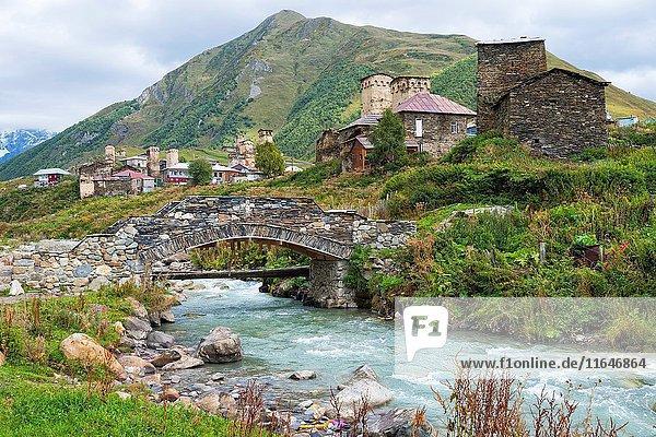 Traditional medieval Svanetian tower houses  Stone bridge over Patara Enguri River  Ushguli village  Svaneti region  Georgia  Caucasus  Middle East  Asia  Unesco World Heritage Site.