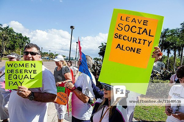 Florida  Miami  Downtown  Bayfront Park  Women's March  political protest  march  human rights  advocacy  sign  man  woman  protesters  signs  social security