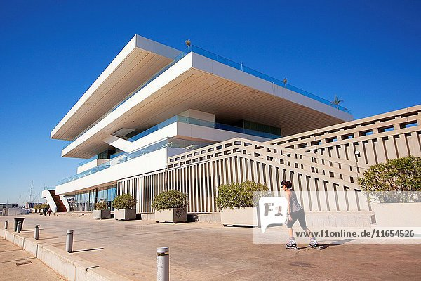 Woman on skateboard in front of the Veles e Vents  building by David Chipperfield  Port Americas Cup  Valencia  Spain  Europe.