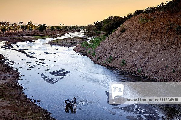 Local Boys Washing A Motorcycle In The Weito River  Omo Valley  Ethiopia.