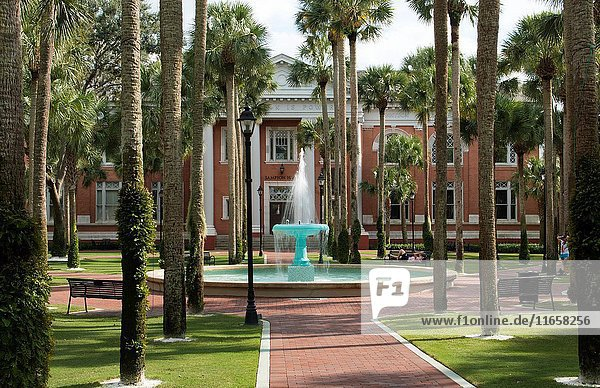 Deland Florida Stetson University fountain and Palm Court with palm trees peaceful in small town education .