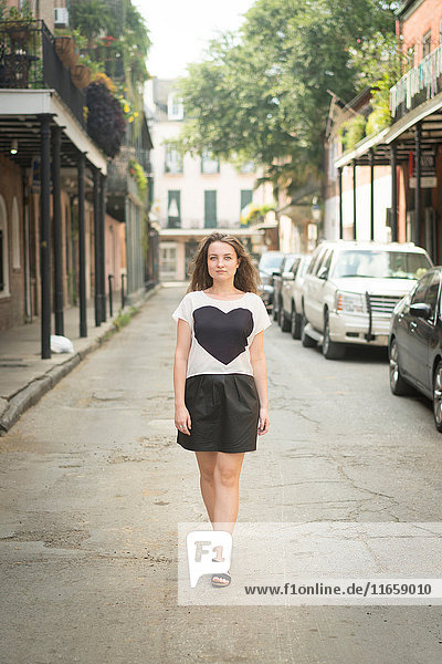 Woman walking in street  French Quarter  New Orleans  Louisiana  USA