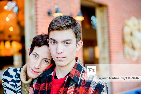 Teenage boy with stylish mother