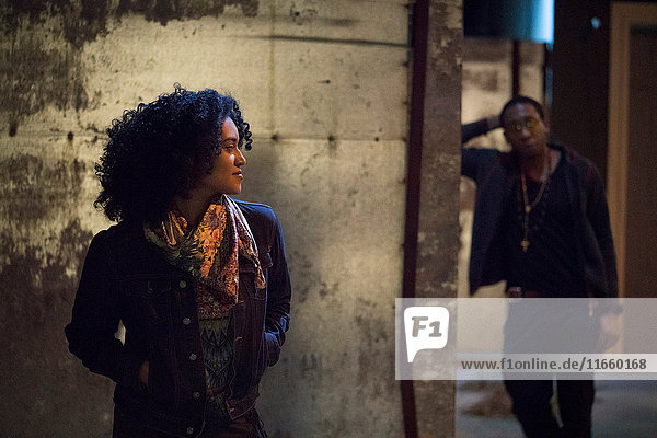 Couple in dimly lit alley  Los Angeles  California  USA