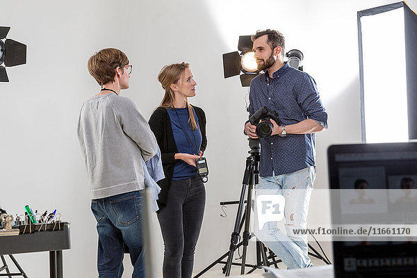 Stylists and photographer talking in photography studio