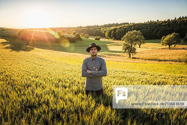 Portrait of mid adult man  standing in field  Neulingen  Baden-Württemberg  Germany