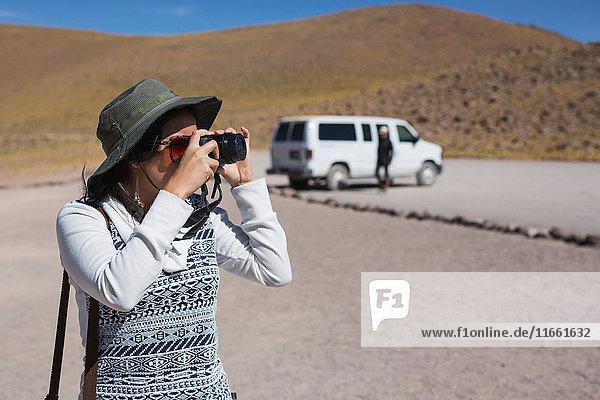 Woman taking photograph  San Pedro de Atacama  Chile