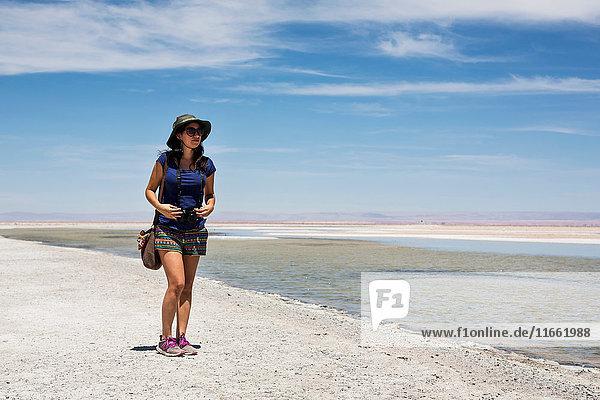 Woman by lake  San Pedro de Atacama  Chile