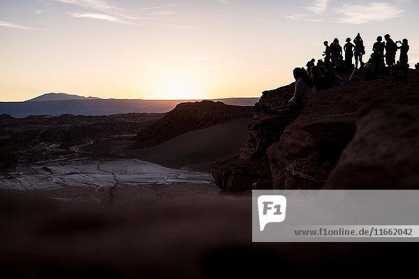 Silhouette of people on mountain at sunset  San Pedro de Atacama  Chile