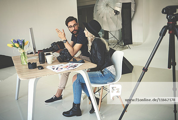 Photographer and stylist meeting in photography studio