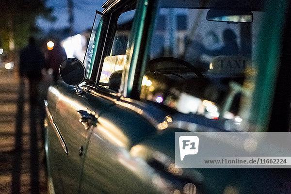 Close up of vintage car on roadside at dusk  Vinales  Cuba