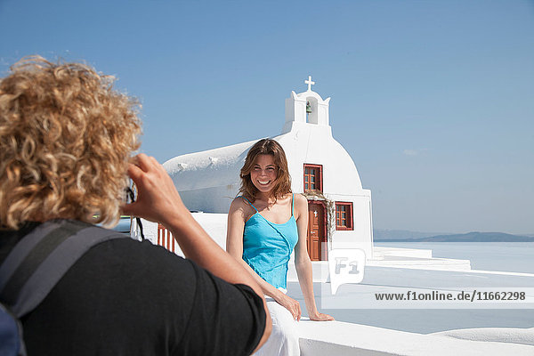 Photographer photographing model  Santorini  Cyclades  Greece