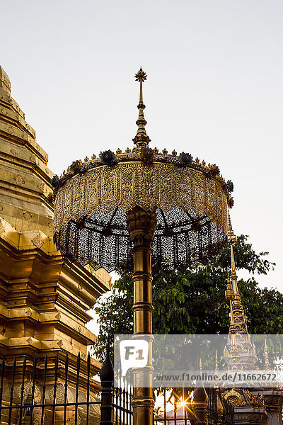Gateway and golden spires of buddhist temple  Chiang Mai  Thailand