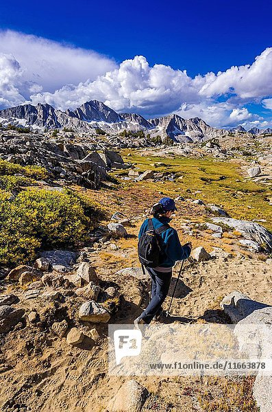 Hiker on the Bishop Pass trail in Dusy Basin,  Kings Canyon National Park,  California USA.
