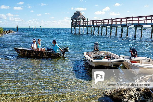 Florida  Upper Florida Keys  Key Largo  Rock Harbor  Atlantic Ocean  Mariner's Club Resort  pier  dinghy  boat  man  woman