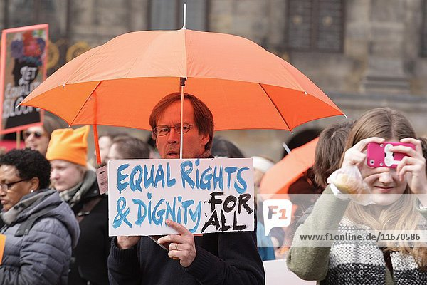 Peope take part in the Womenâ.s March For The Nethelends demonstration at Dam square to celebrate the international Women's Day and the upcoming Dutch election  in solidarity against hate and all forms of discrimination on March 11th  2017 in Amsterdam Netherlands.