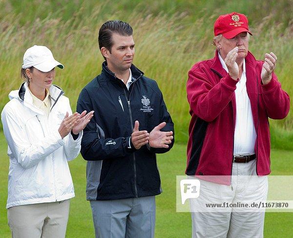 Ivanka Trump  Donald Junior and Donald Trump. Opening of Trump International Golf Links. Official opening of Donald Trump's golf course at the Menie Estate  Aberdeen. International golfers joined Donald Trump in hitting the first tee. Menie Estate  Aberdeenshire  Scotland  2012/07/10