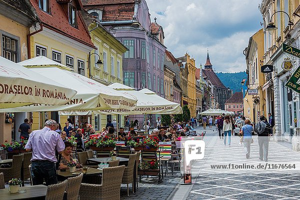 Restaurants at Republic Street  main pedestrian thoroughfare full of shops and restaurants in Brasov  Romania.
