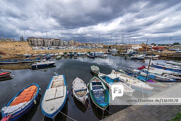 Local fisherman's boats at the marina in Syracuse city  southeast corner of the island of Sicily  Italy.