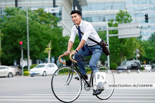 Young man riding a bicycle