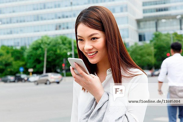 Young woman holding a cell phone