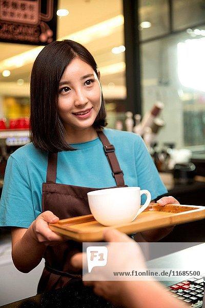 Cafe waiter and customer