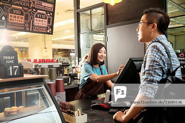 Cafe cashier and customer