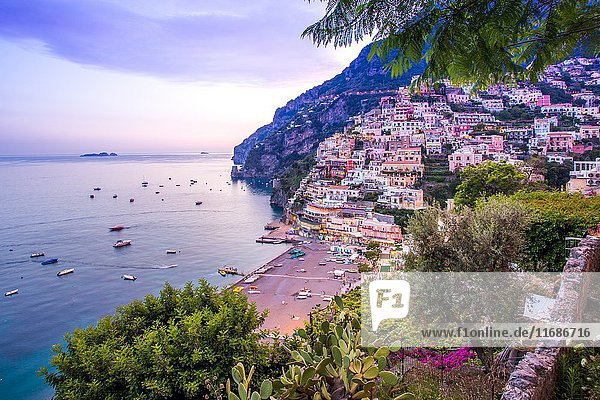 Positano  Amalfi Coast  Campania  Sorrento  Italy. View of the town and the seaside in a summer sunset.