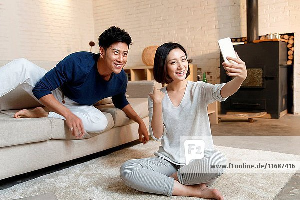 Young couple taking self portrait with smart phone