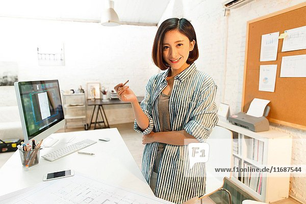 Young woman working at home studio