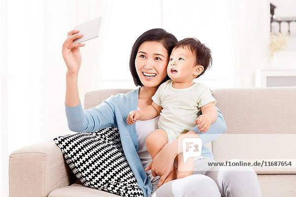 Mother and son taking selfie photo