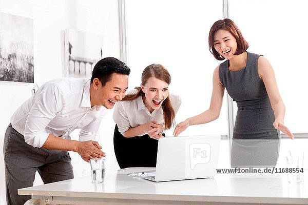 Three business people in office