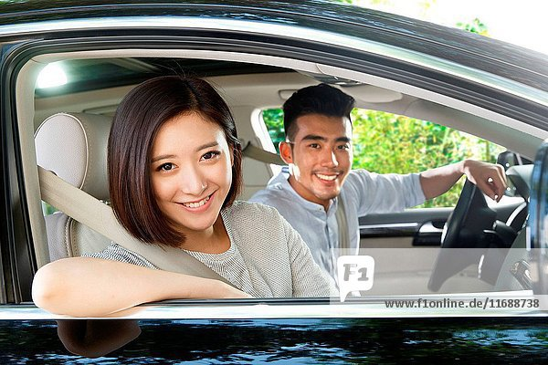 Young couple driving on trip