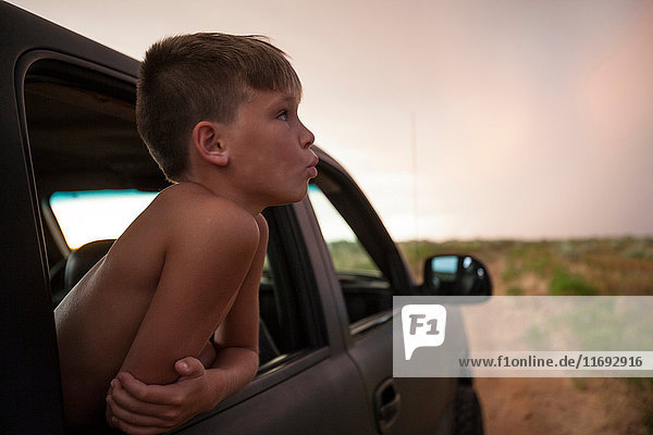 Boys looking out of car window