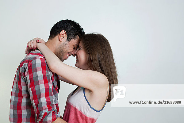 Young couple embracing  studio shot