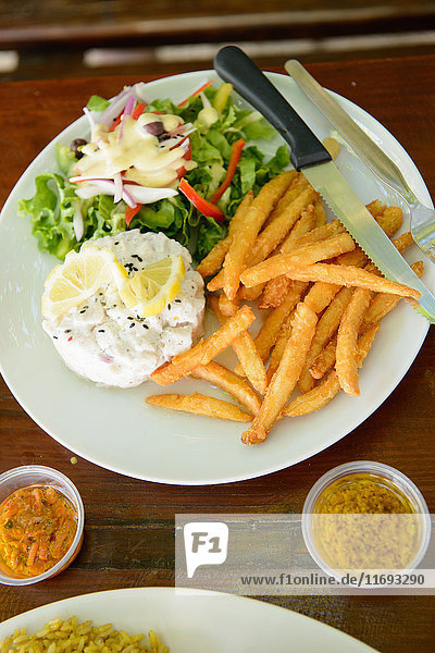 Plate of fries  dinner salad and eggs