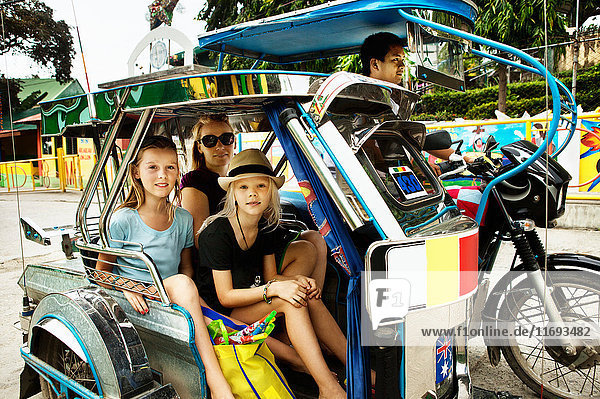 Family riding in alternative transport