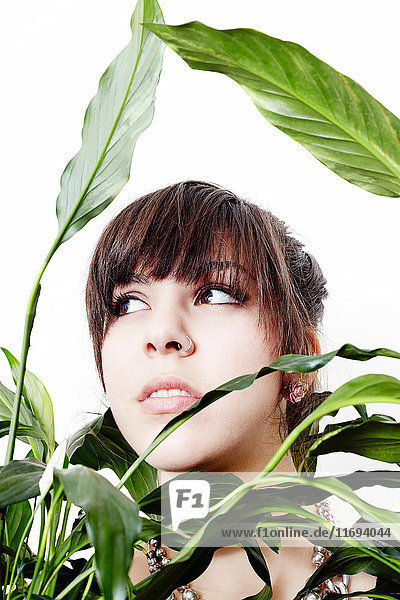 Portrait of a young woman in a plant