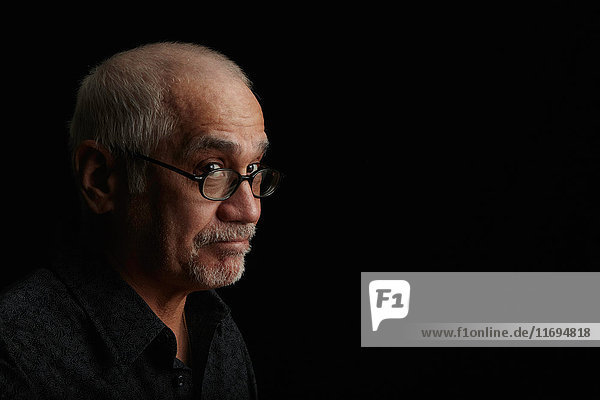 Smiling older man wearing eyeglasses