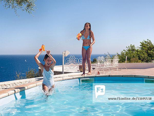 Teenage girls playing in swimming pool