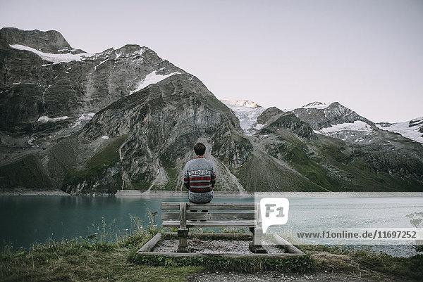 Caucasian man admiring scenic view of mountain lake
